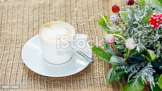 885959540istockphoto Cup of coffee with latte art. Leisure time concept. Pastel colors 868514680