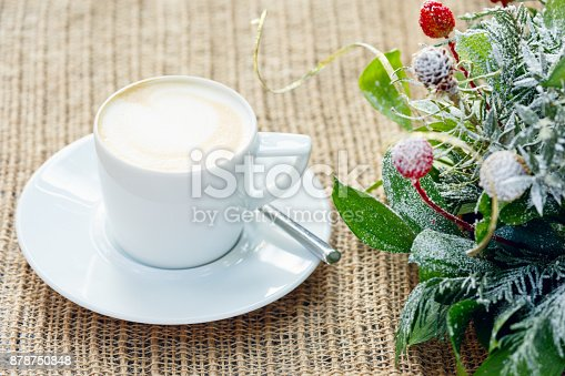 885959540istockphoto Cup of coffee with latte art. Leisure time concept. Pastel colors 878750848