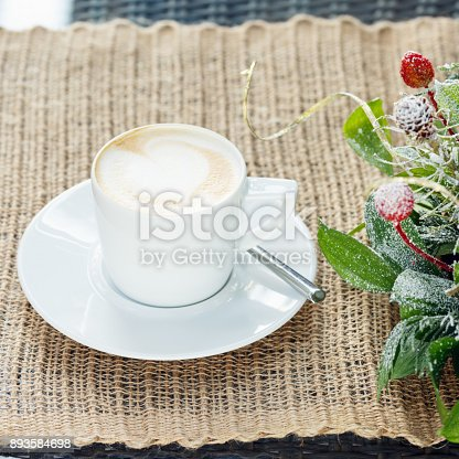 885959540istockphoto Cup of coffee with latte art. Leisure time concept. Pastel colors 893584698