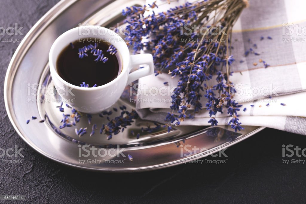 Cup of coffee with lavender flowers on table royalty-free stock photo