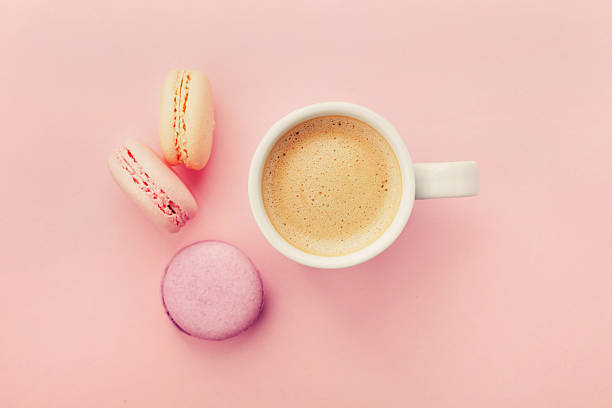 cup of coffee with macaron on pink background from above - color intensity stock pictures, royalty-free photos & images