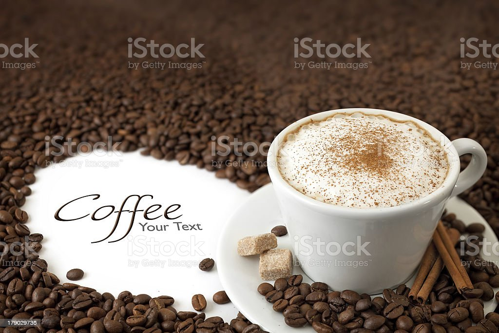 Cup of Coffee with Milk Foam, Cinnamon and Lum Sugar royalty-free stock photo