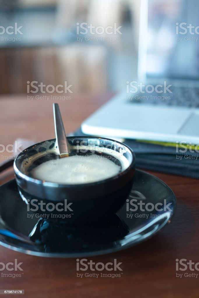 Cup of coffee with notebook background, Selective focus foto de stock royalty-free