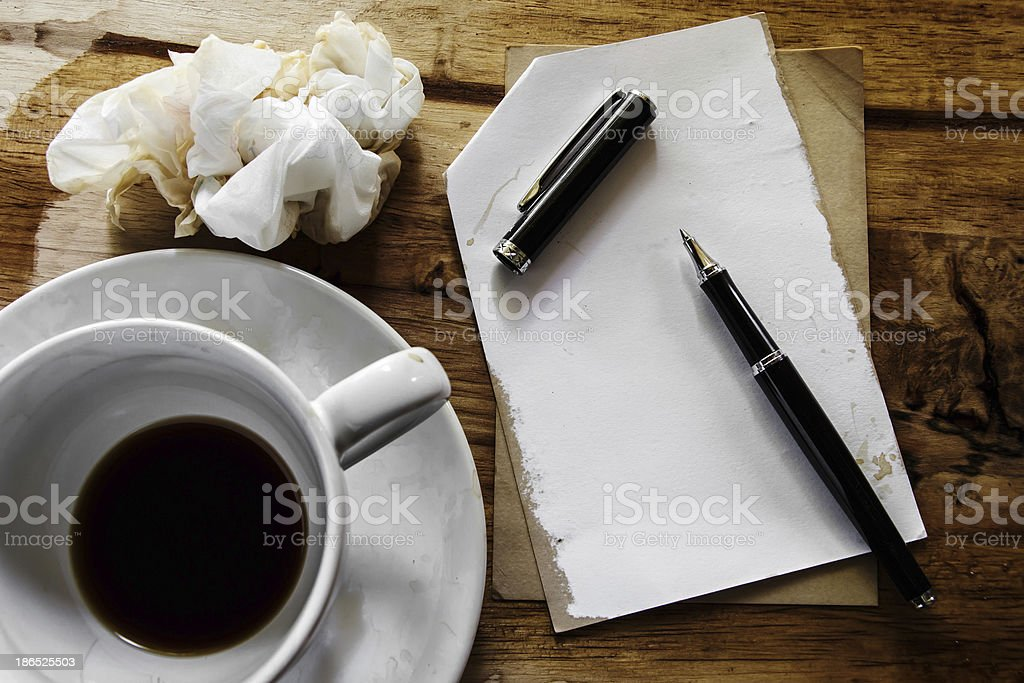 Cup of coffee with notepad, pen and paper on desk royalty-free stock photo