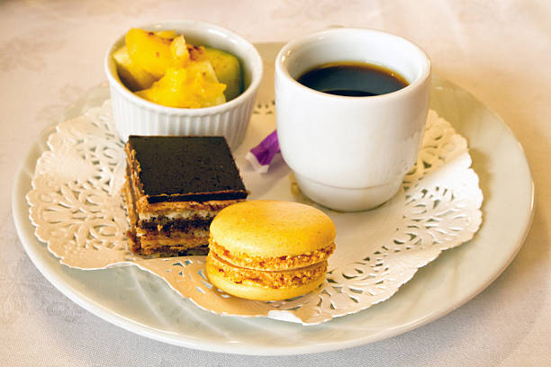 cup of coffee with petit fours stock photo