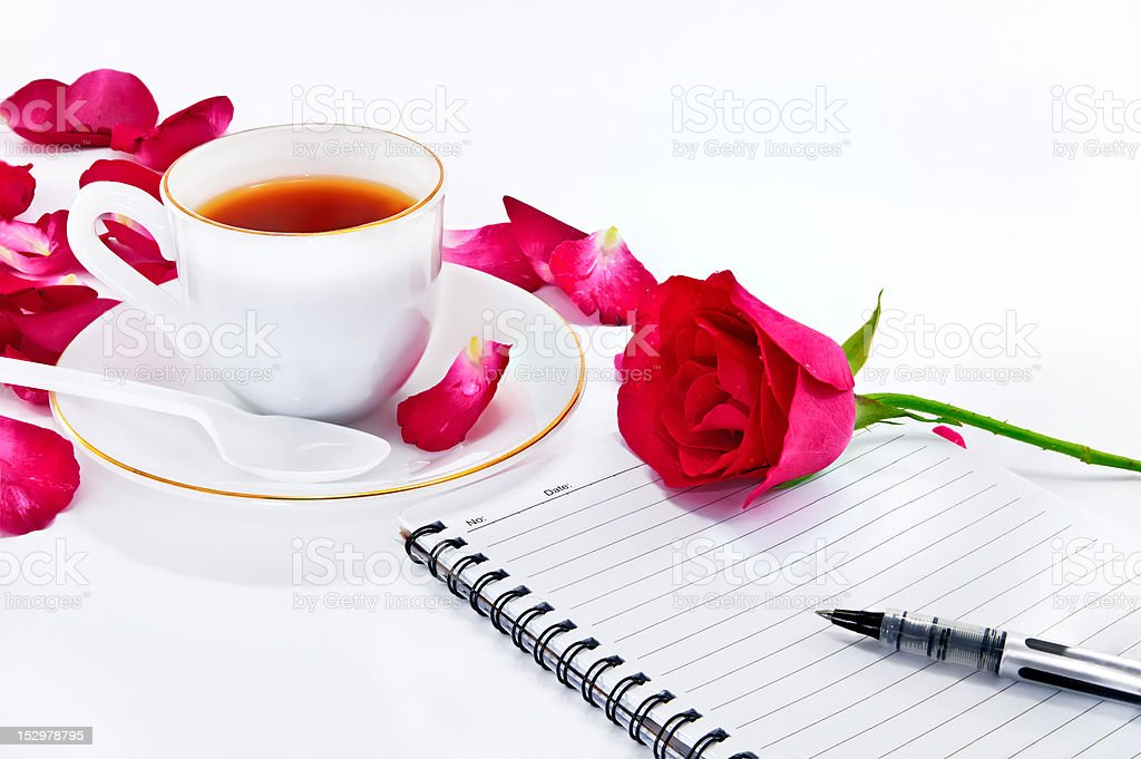 cup of coffee with red roses and notebook royalty-free stock photo