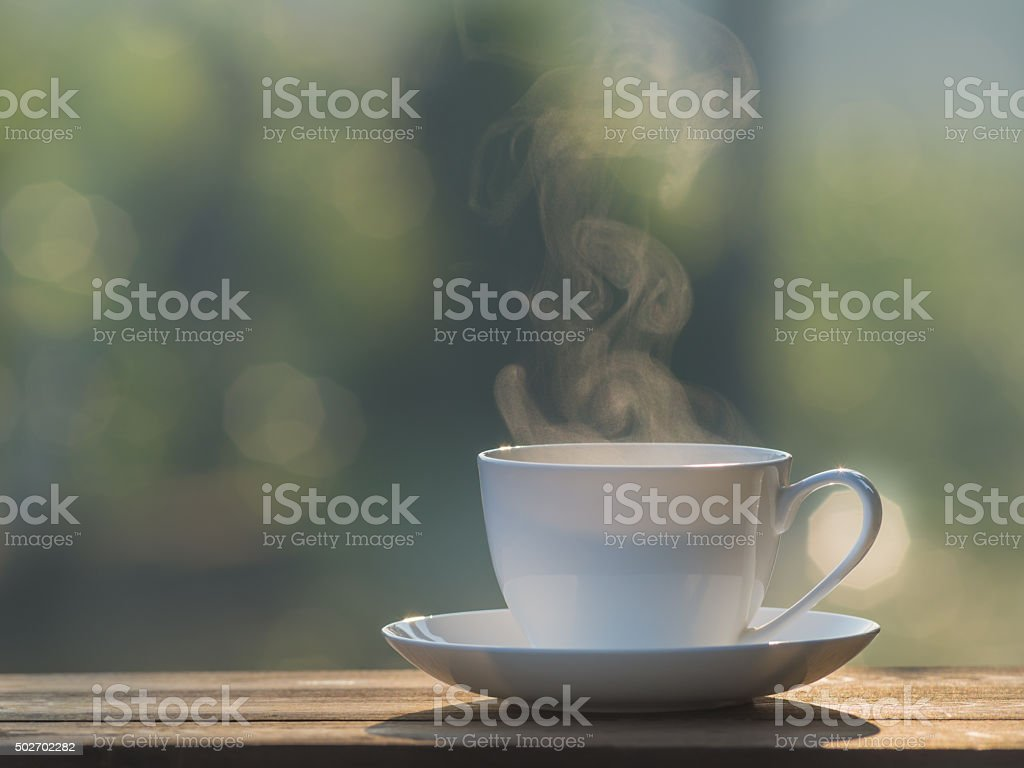 Cup of coffee with smoke in the morning