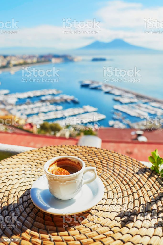 Cup of coffee with view on Vesuvius mount in Naples stock photo