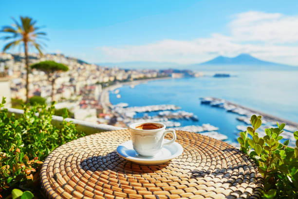Cup of coffee with view on Vesuvius mount in Naples Cup of fresh espresso coffee in a cafe with view on Vesuvius mount in Naples, Campania, Southern Italy mediterranean sea stock pictures, royalty-free photos & images