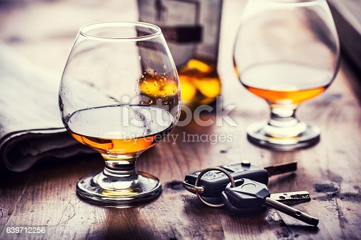 istock Cup of cognac whiskey or brandy and the keys car. 639712256