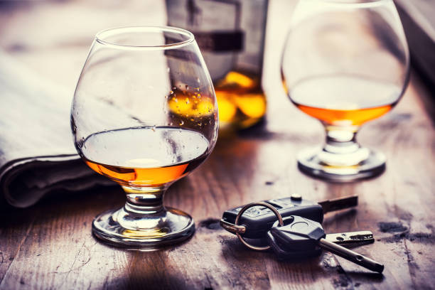 Cup of cognac whiskey or brandy and the keys car. stock photo