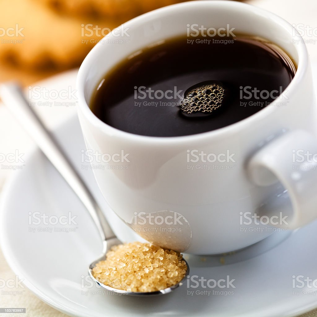 Cup of delicious black coffee and brown sugar stock photo
