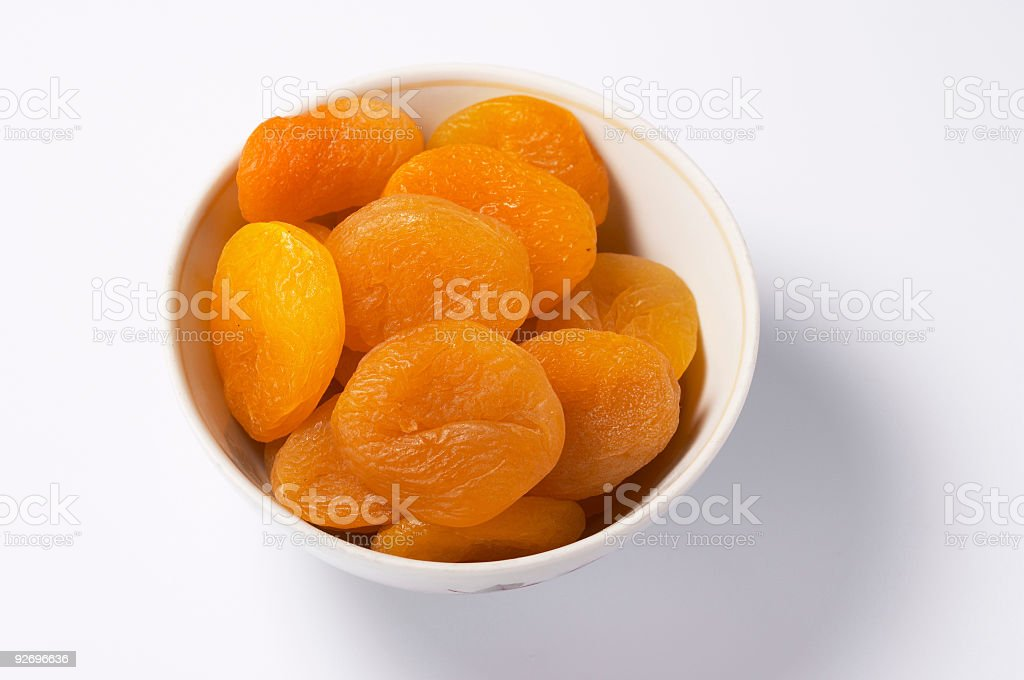 Cup of dried apricots stock photo