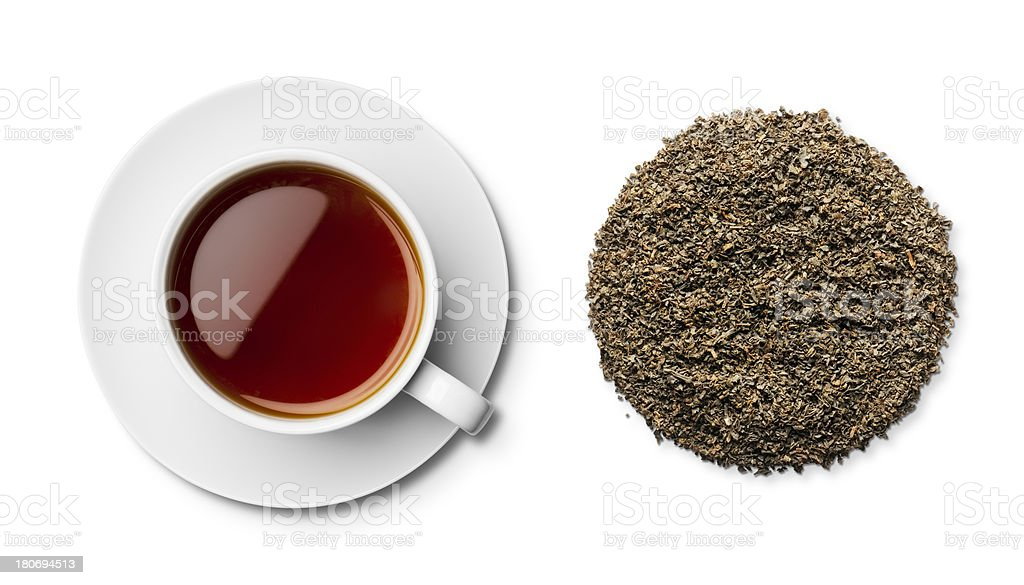 Cup of earl grey tea and leaves overhead stock photo