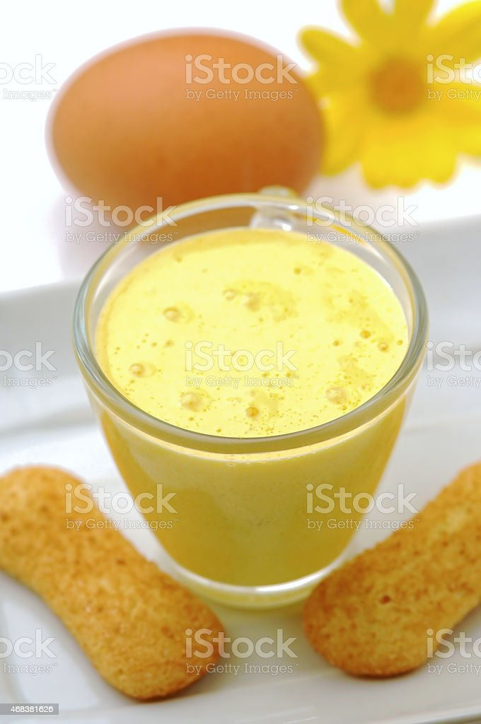 Cup of eggnog with cookies  on white background stock photo