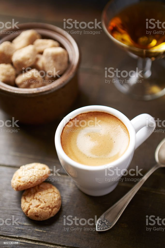 Cup of Espresso and a Glass of Amaretto stock photo