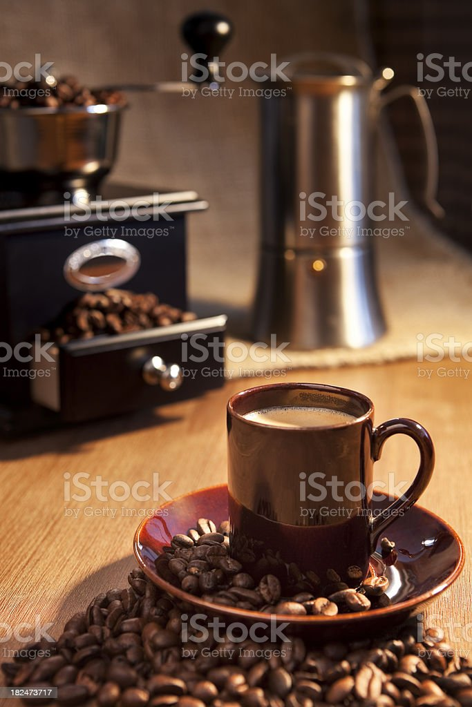 Cup of espresso coffee and coffee grinder on a table royalty-free stock photo