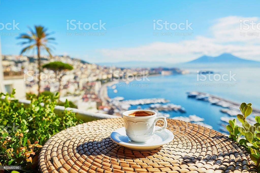 Cup of espresso coffee with view on Vesuvius stock photo