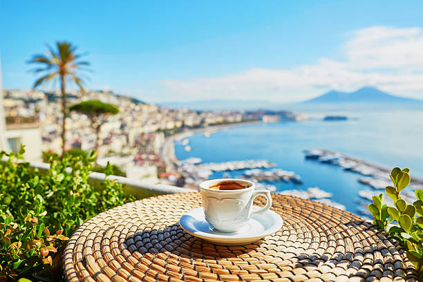 cup of espresso coffee with view on vesuvius - italien urlaubsziele stock-fotos und bilder