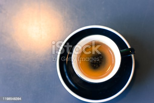 Cup of Espresso, Gray Table, Overhead Light