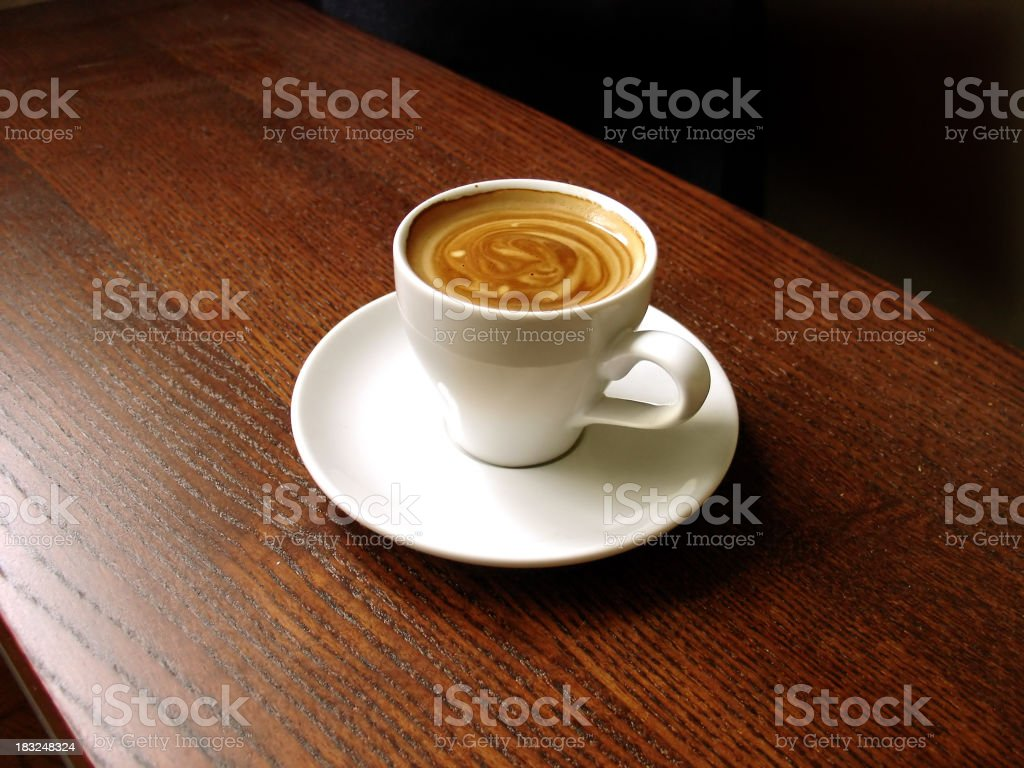 A cup of espresso on a wooden table  royalty-free stock photo