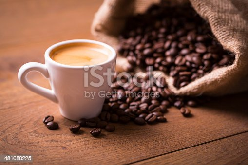 istock cup of espresso shot with coffee beans on wooden table 481080225