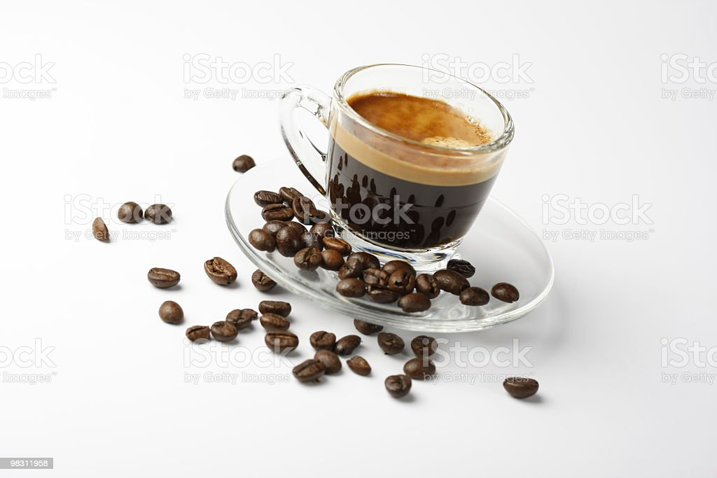 cup of espresso shot with crema and some coffee beans royalty-free stock photo