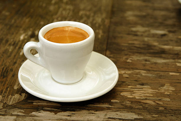 A cup of espresso sitting a white saucer stock photo
