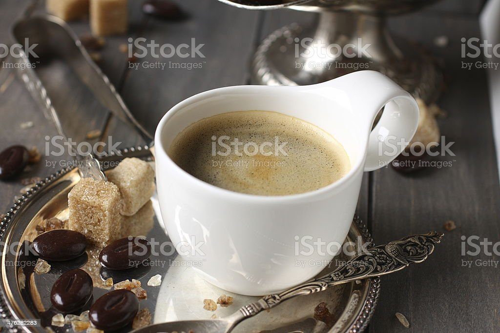 Cup of espresso, sugar cubes and chocolate candy royalty-free stock photo