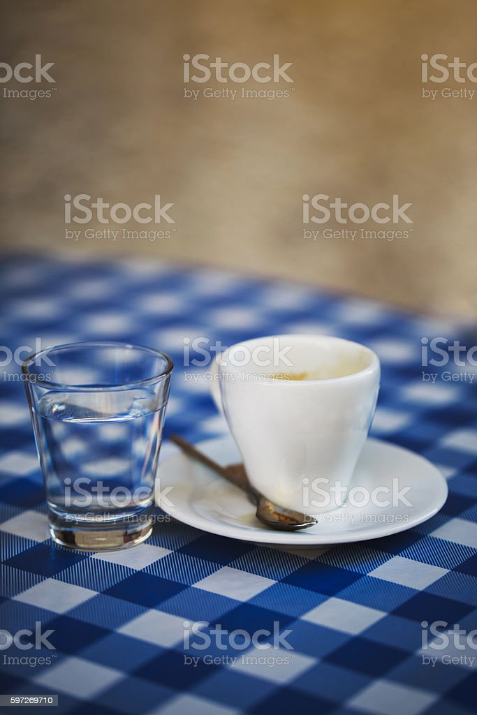 Cup of espresso with water on the table royalty-free stock photo