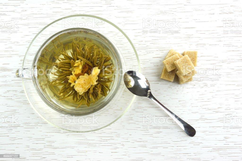 Cup of flowering tea stock photo