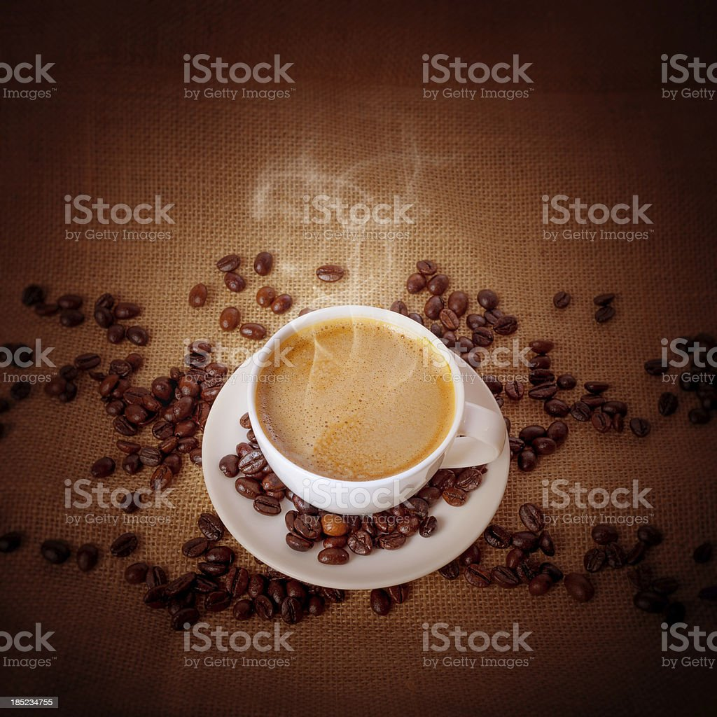 Cup of fresh cappuccino on burlap background royalty-free stock photo