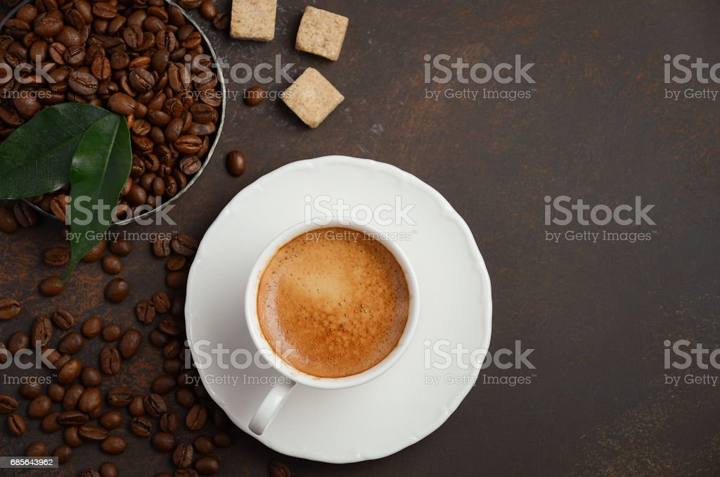 Cup of fresh coffee with coffee beans on dark background. royalty-free stock photo