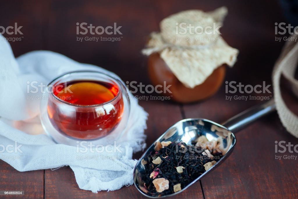 cup of freshly brewed tea  on wooden background with caramel sug royalty-free stock photo