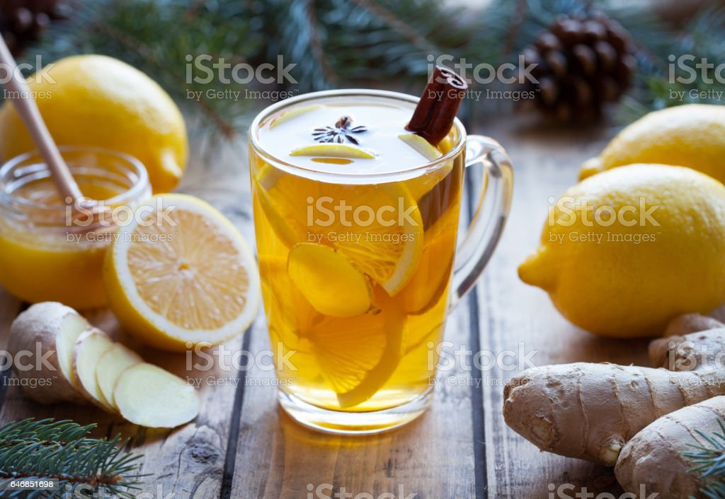 Cup of green natural tea with ginger, lemon and honey on wooden vintage background. Healthy drink. stock photo