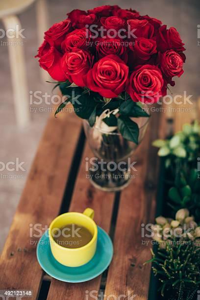 Cup of green tea and a bouquet of roses picture id492123148?b=1&k=6&m=492123148&s=612x612&h=qnjbtazvft2eemaerrdj kk5fmsrqdqhybzjjl5wyzm=