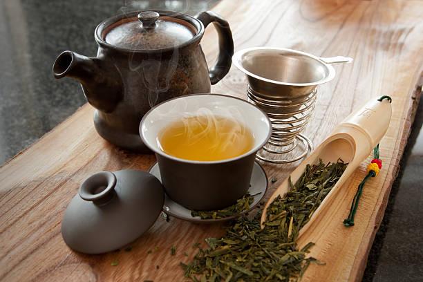 Tasse grüner Tee und Zubehör – Foto