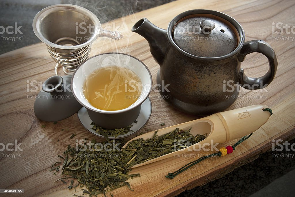 Cup of green tea and accessories stock photo