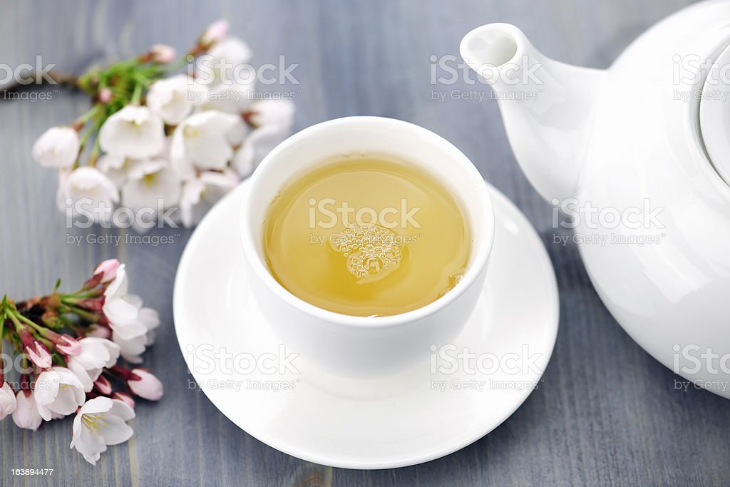 Cup of green tea and japanese cherry blossom stock photo
