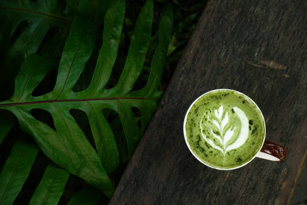 A cup of green tea matcha latte stock photo