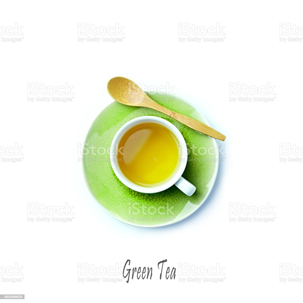 Cup of Green Tea on white background; flatlay stock photo