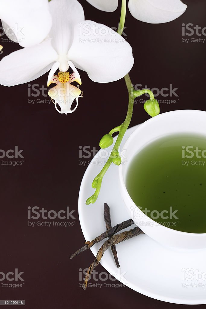 cup of green tea with white orchid, royalty-free stock photo