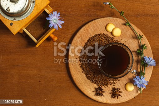 An invigorating drink made from granulated chicory root for those who care about health, contains a large amount of inulin, trace elements and vitamins. Low key layout, wooden background