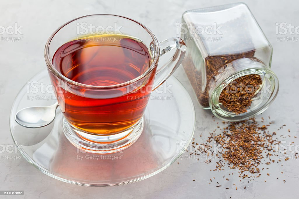 Cup of healthy herbal rooibos red tea in glass cup stock photo