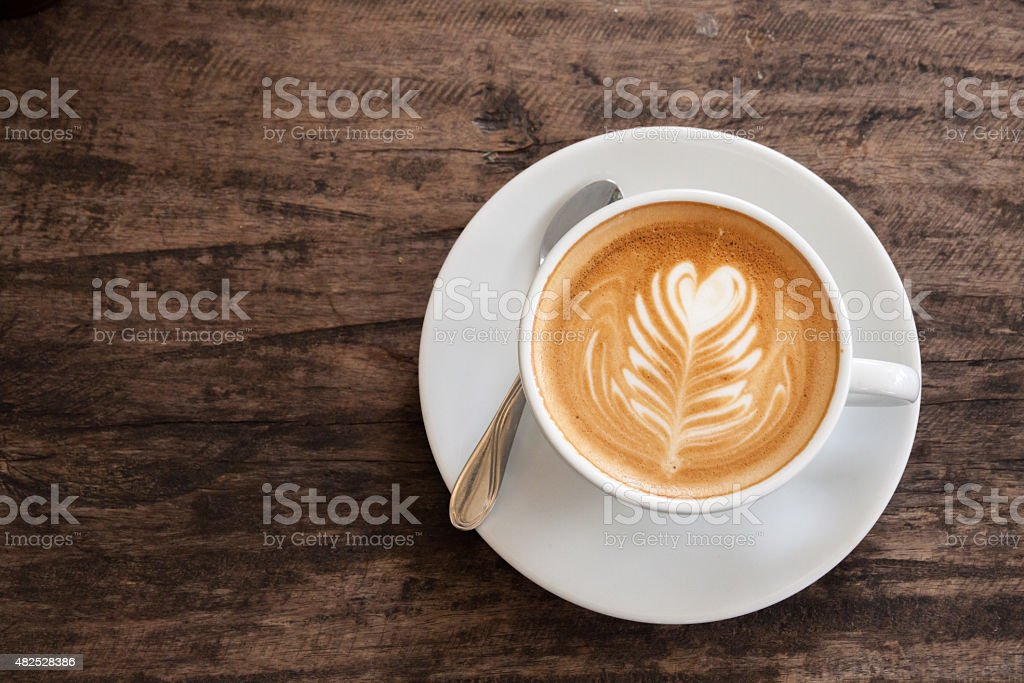 Cup of heart latte art stock photo