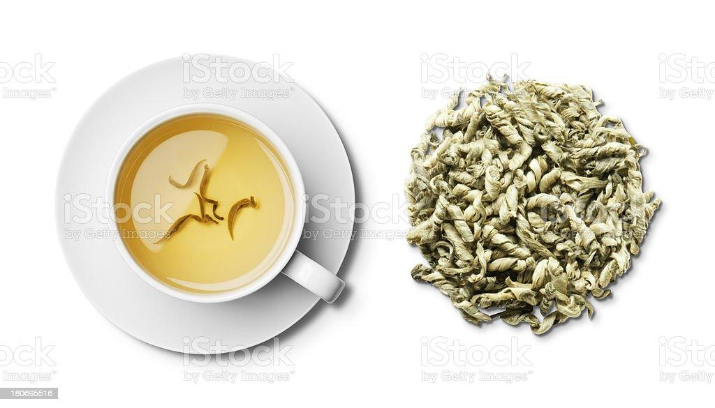 Cup of herbal snow dragon tea and tea leaves overhead stock photo