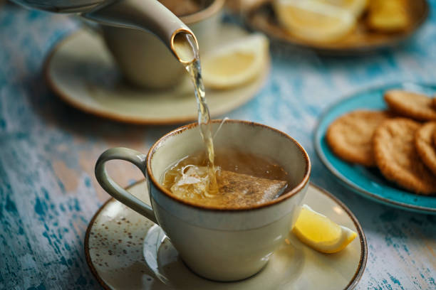 Cup of Herbal Tea Served with Biscuits stock photo