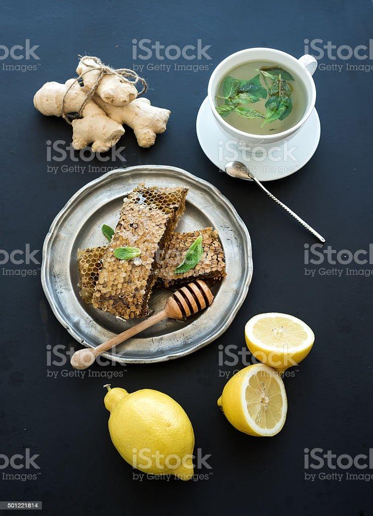 Cup of herbal tea with fresh mint, honey, lemon, ginger stock photo