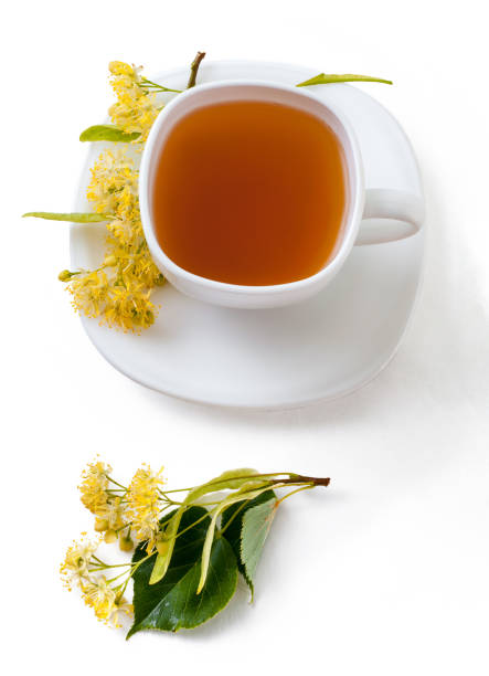 cup of herbal tea with linden flowers isolated on white background stock photo