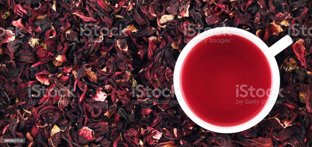 Cup of hibiscus tea on the leaves, panorama stock photo